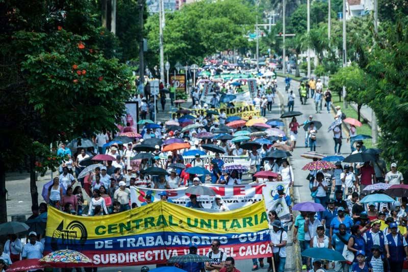 Centrales obreras mantienen convocatoria de paro pese a pico de contagios