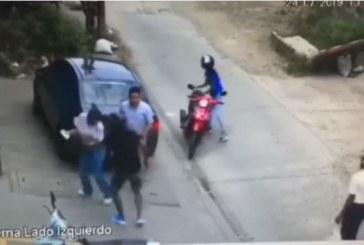 Buscan a hombre y mujer que quedaron en video robando a pareja en el norte de Cali